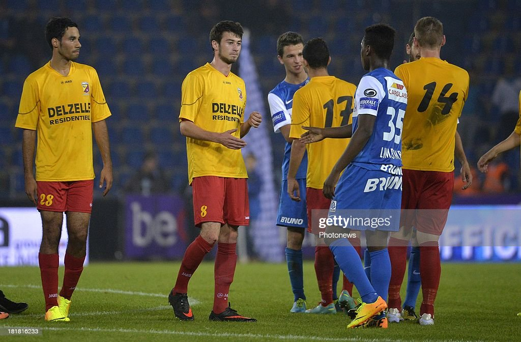 Diogo Inacio Ribeiro of AFC Tubize - Lou Wallaert of AFC Tubize - Anthony Limbombe of Krc Genk during the Cofidis Cup match between KRC Genk and AFC Tubize on September 25, 2013 in Genk, Belgium.