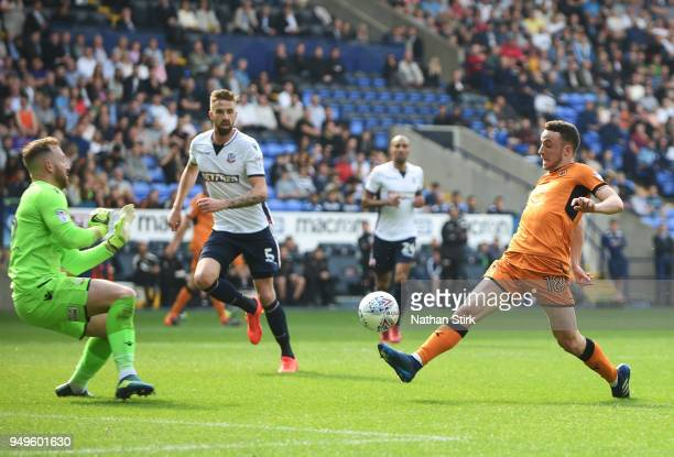 Diogo Jose Teixeira da Silva of Wolverhampton Wanderers scores their third goal of the game during the Sky Bet Championship match between Bolton...
