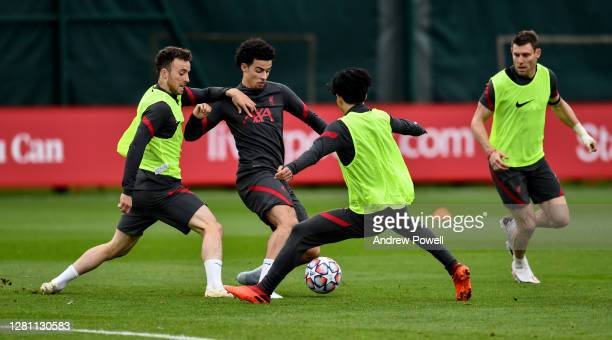 Diogo Jota and Curtis Jones of Liverpool during a training session at Melwood Training Ground on October 19 2020 in Liverpool England