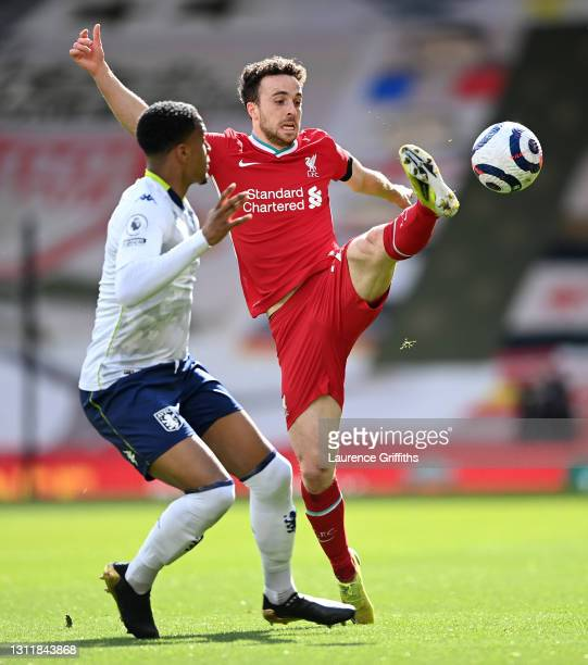 Diogo Jota of Liverpool battles for possession with Ezri Konsa of Aston Villa during the Premier League match between Liverpool and Aston Villa at...