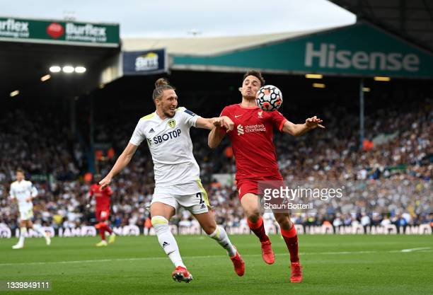 Diogo Jota of Liverpool battles for possession with Luke Ayling of Leeds United during the Premier League match between Leeds United and Liverpool at...