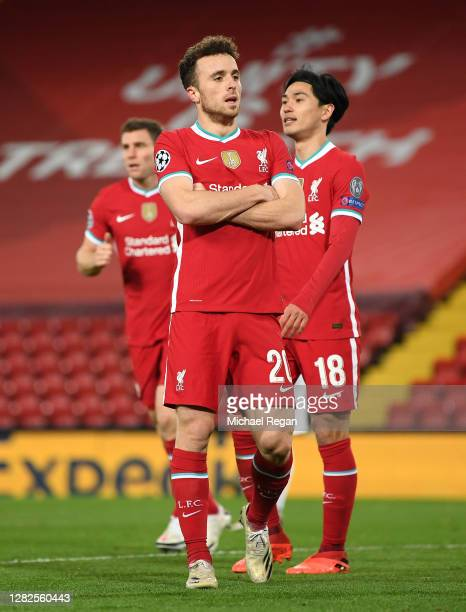 Diogo Jota of Liverpool celebrates after scoring his team's first goal during the UEFA Champions League Group D stage match between Liverpool FC and...