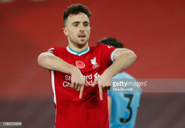 Diogo Jota of Liverpool celebrates after scoring his team's second goal during the Premier League match between Liverpool and West Ham United at...