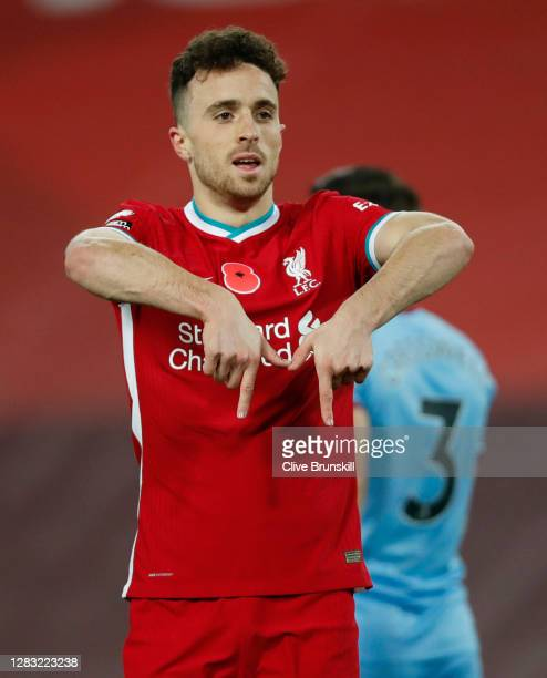 Diogo Jota of Liverpool celebrates after scoring his team's second goal which is later ruled offside by VAR during the Premier League match between...