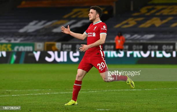 Diogo Jota of Liverpool celebrates after scoring their side's first goal during the Premier League match between Wolverhampton Wanderers and...