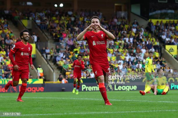 Diogo Jota of Liverpool celebrates after scoring their side's first goal during the Premier League match between Norwich City and Liverpool at Carrow...