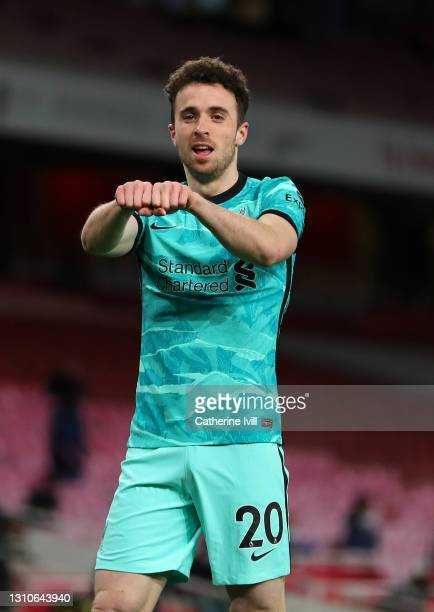 Diogo Jota of Liverpool celebrates after scoring their team's first goal during the Premier League match between Arsenal and Liverpool at Emirates...