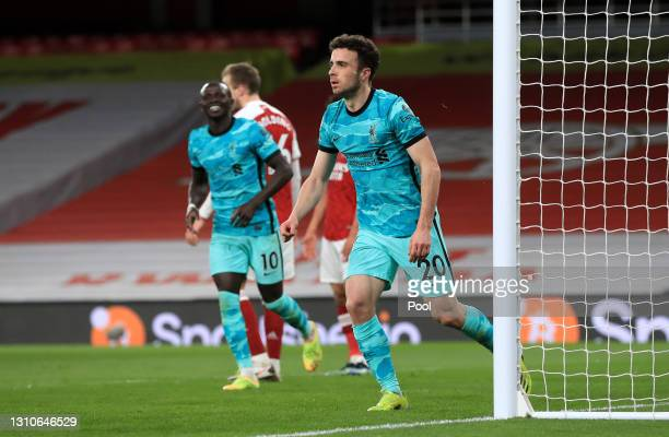Diogo Jota of Liverpool celebrates after scoring their team's third goal during the Premier League match between Arsenal and Liverpool at Emirates...