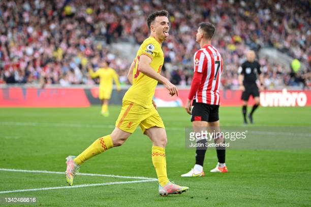 Diogo Jota of Liverpool celebrates scoring his sides first goal during the Premier League match between Brentford and Liverpool at Brentford...
