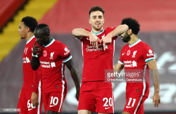 Diogo Jota of Liverpool celebrates scoring his teams second goal during the Premier League match between Liverpool and West Ham United at Anfield on...
