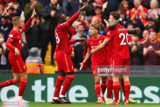 Diogo Jota of Liverpool celebrates with Naby Keita and team mates after scoring their side's first goal during the Premier League match between...