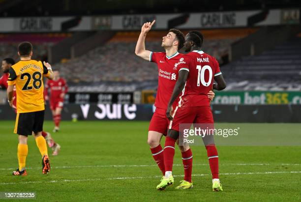 Diogo Jota of Liverpool celebrates with team mate Sadio Mane after scoring their side's first goal during the Premier League match between...