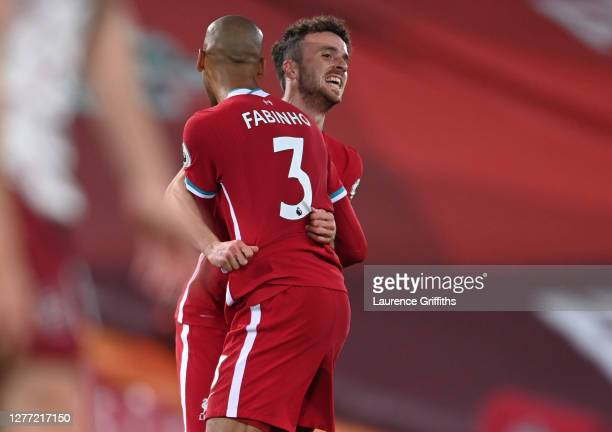 Diogo Jota of Liverpool celebrates with teammate Fabinho after scoring his sides third goal during the Premier League match between Liverpool and...