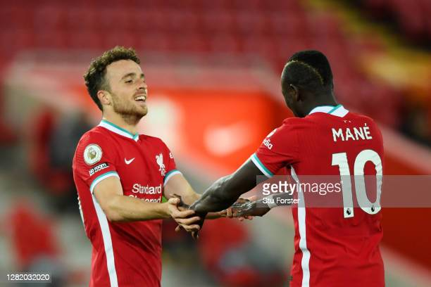 Diogo Jota of Liverpool celebrates with teammate Sadio Mane after scoring his team's second goal during the Premier League match between Liverpool...