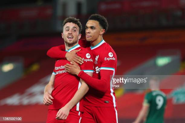 Diogo Jota of Liverpool celebrates with teammate Trent Alexander-Arnold after scoring his team's second goal during the Premier League match between...