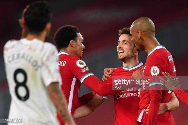 Diogo Jota of Liverpool celebrates with teammates after scoring his sides third goal during the Premier League match between Liverpool and Arsenal at...