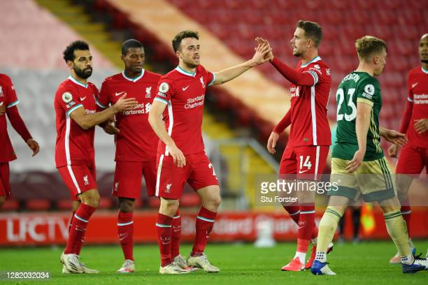 Diogo Jota of Liverpool celebrates with teammates after scoring his team's second goal during the Premier League match between Liverpool and...