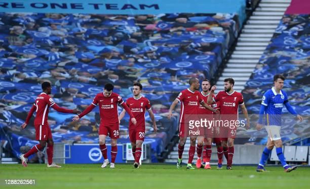 Diogo Jota of Liverpool celebrates with teammates Georginio Wijnaldum, Andrew Robertson, Fabinho, Nathaniel Phillips and Jordan Henderson after...
