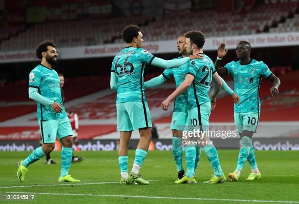 Diogo Jota of Liverpool celebrates with teammates Mohamed Salah, Trent Alexander-Arnold, Thiago Alcantara and Sadio Mane after scoring their team's...
