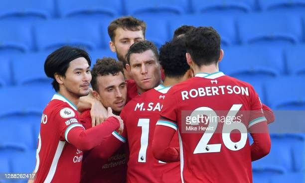 Diogo Jota of Liverpool celebrates with teammates Takumi Minamino, Mohamed Salah, Andrew Robertson and James Milner after scoring their team's first...