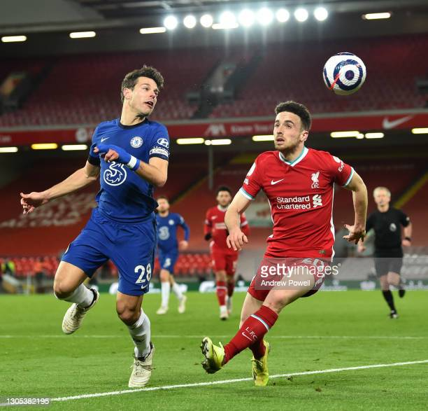 Diogo Jota of Liverpool Chelsea's Cesar Azpilicueta during the Premier League match between Liverpool and Chelsea at Anfield on March 04, 2021 in...