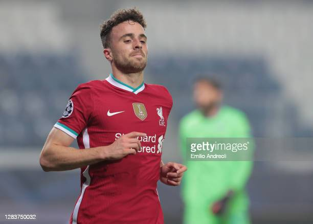 Diogo Jota of Liverpool FC celebrates after scoring the opening goal during the UEFA Champions League Group D stage match between Atalanta BC and...