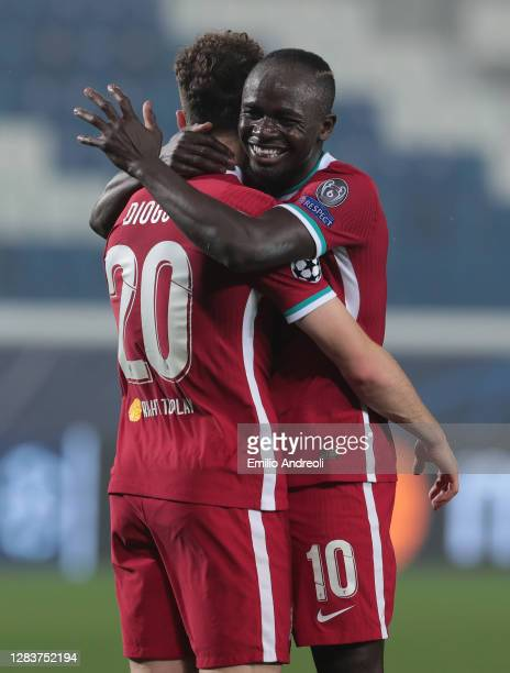 Diogo Jota of Liverpool FC celebrates his second goal with his team-mate Sadio Mane during the UEFA Champions League Group D stage match between...