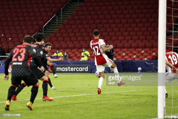 AMSTERDAM Diogo Jota of Liverpool FC Noussair Mazraoui of Ajax Zakaria Labyad or Ajax during the UEFA Champions League match in group D between Ajax...