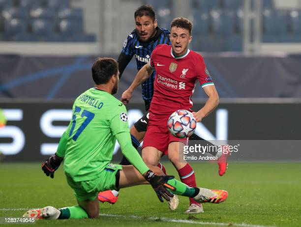 Diogo Jota of Liverpool FC scores the opening goal during the UEFA Champions League Group D stage match between Atalanta BC and Liverpool FC at...