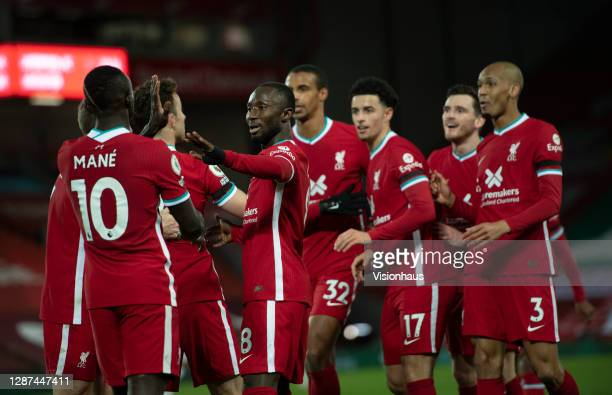 Diogo Jota of Liverpool is congratulated by Naby Keita and team mates after scoring during the Premier League match between Liverpool and Leicester...