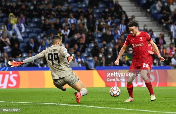 Diogo Jota of Liverpool misses a chance whilst under pressure from Diego Costa of FC Porto during the UEFA Champions League group B match between FC...