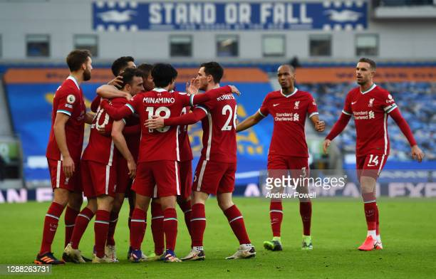 Diogo Jota of Liverpool opens the scoring and celebrates during the Premier League match between Brighton & Hove Albion and Liverpool at American...