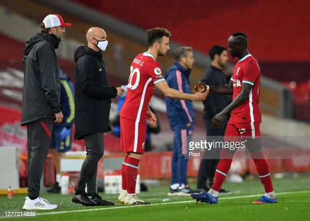 Diogo Jota of Liverpool replaces teammate Sadio Mane during the Premier League match between Liverpool and Arsenal at Anfield on September 28, 2020...