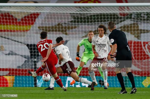 Diogo Jota of Liverpool scores his sides third goal during the Premier League match between Liverpool and Arsenal at Anfield on September 28, 2020 in...