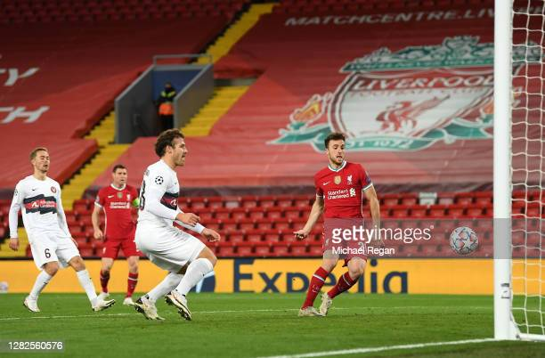 Diogo Jota of Liverpool scores his team's first goal during the UEFA Champions League Group D stage match between Liverpool FC and FC Midtjylland at...