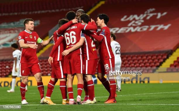 Diogo Jota of Liverpool scores the opener for liverpool and celebrates during the UEFA Champions League Group D stage match between Liverpool FC and...