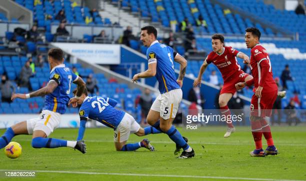 Diogo Jota of Liverpool scores their team's first goal during the Premier League match between Brighton & Hove Albion and Liverpool at American...