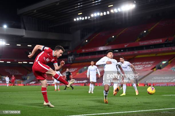 Diogo Jota of Liverpool shoots past James Justin of Leicester City during the Premier League match between Liverpool and Leicester City at Anfield on...