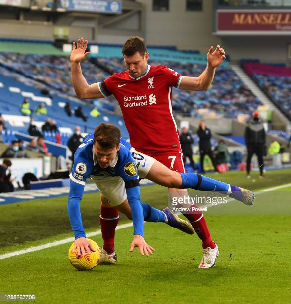 Diogo Jota of Liverpool with Brighton & Hove Albion's Solly March during the Premier League match between Brighton & Hove Albion and Liverpool at...