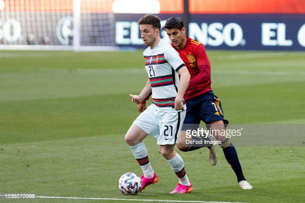 Diogo Jota of Portugal and Alvaro Morata of Spain battle for the ball during the international friendly match between Spain and Portugal at Estadio...