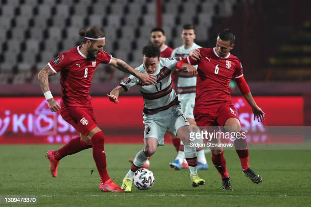 Diogo Jota of Portugal is put under pressure by Nemanja Gudelj and Nemanja Maksimovic of Serbia during the FIFA World Cup 2022 Qatar qualifying match...