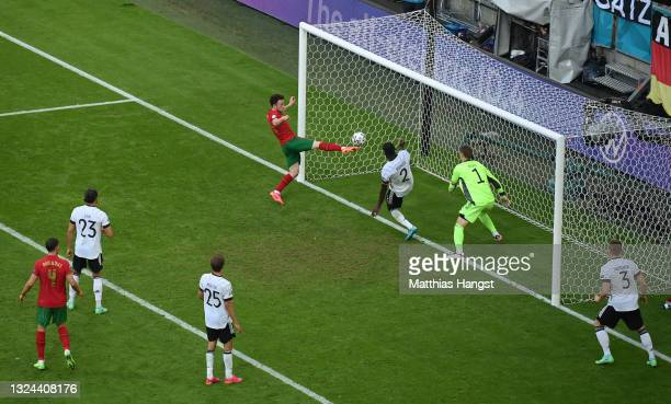 Diogo Jota of Portugal scores their side's second goal past Manuel Neuer of Germany during the UEFA Euro 2020 Championship Group F match between...