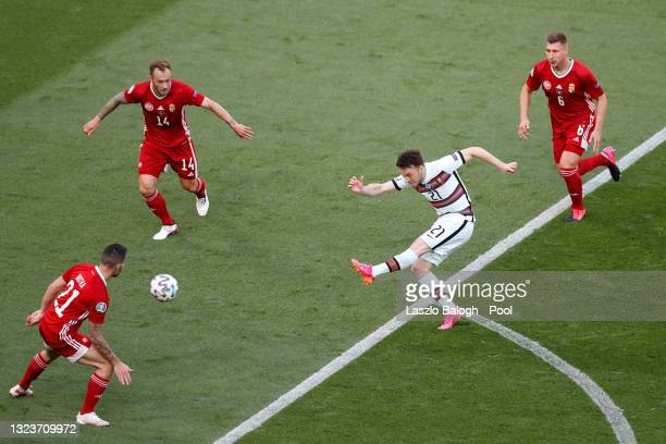 Diogo Jota of Portugal shoots whilst under pressure from Gergo Lovrencsics and Willi Orban of Hungary during the UEFA Euro 2020 Championship Group F...