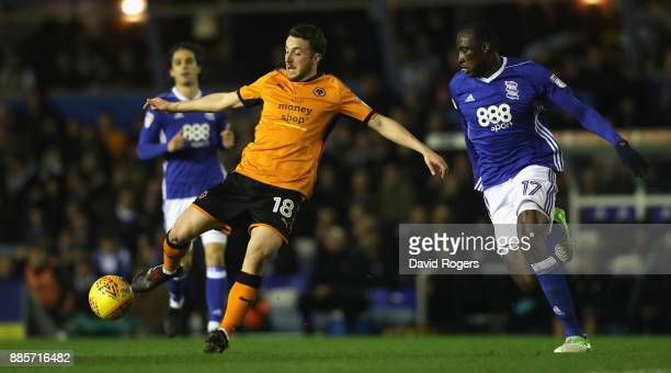 Diogo Jota of Wolverhampton controls the ball as Cheikh Ndoyo challenges during the Sky Bet Championship match between Birmingham City and...