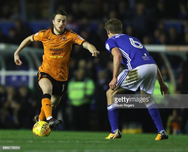 Diogo Jota of Wolverhampton takes on Maikel Kieftenbeld during the Sky Bet Championship match between Birmingham City and Wolverhampton Wanderers at...