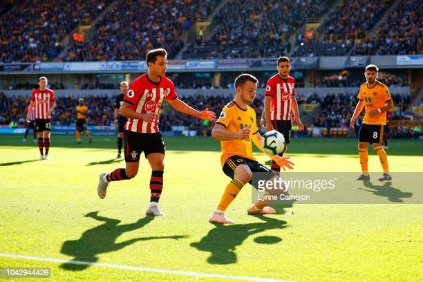 Diogo Jota of Wolverhampton Wanderers and Cedric Soares of Southampton compete for the ball during the Premier League match between Wolverhampton...