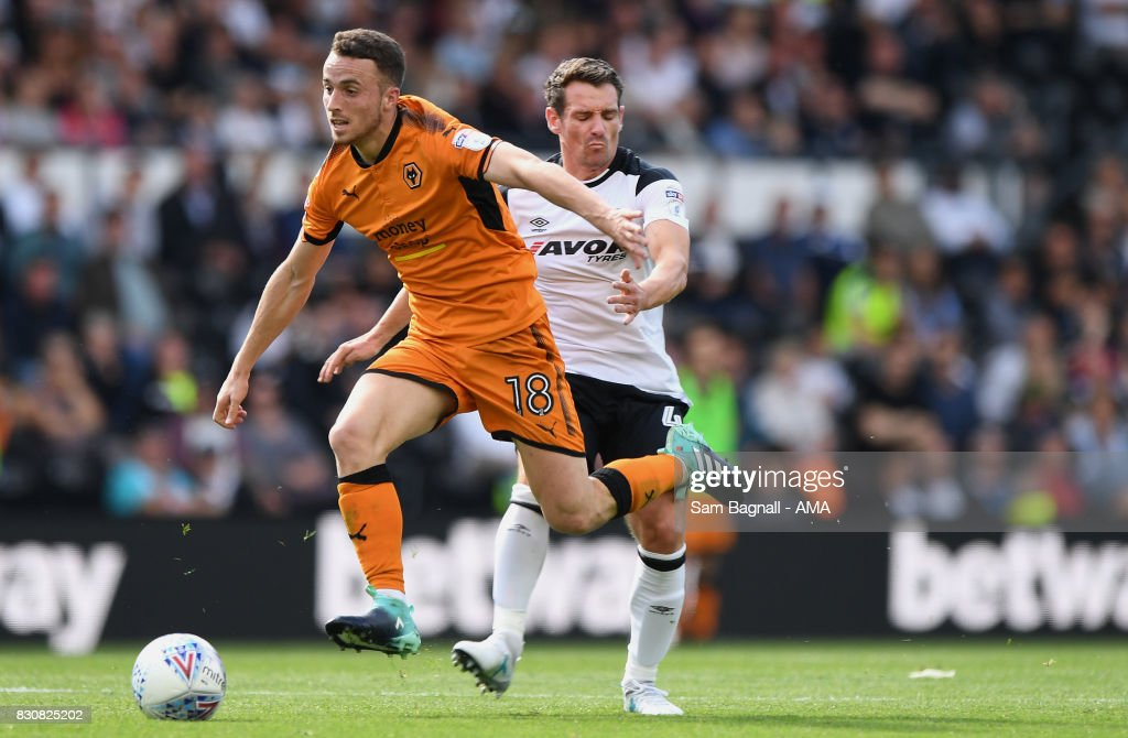 Diogo Jota of Wolverhampton Wanderers and Craig Bryson of Derby County during the Sky Bet Championship match between Derby County and Wolverhampton at iPro Stadium on August 12, 2017 in Derby, England.