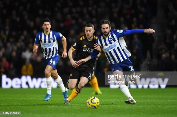 Diogo Jota of Wolverhampton Wanderers and Davy Propper of Brighton and Hove Albion during the Premier League match between Brighton & Hove Albion and...