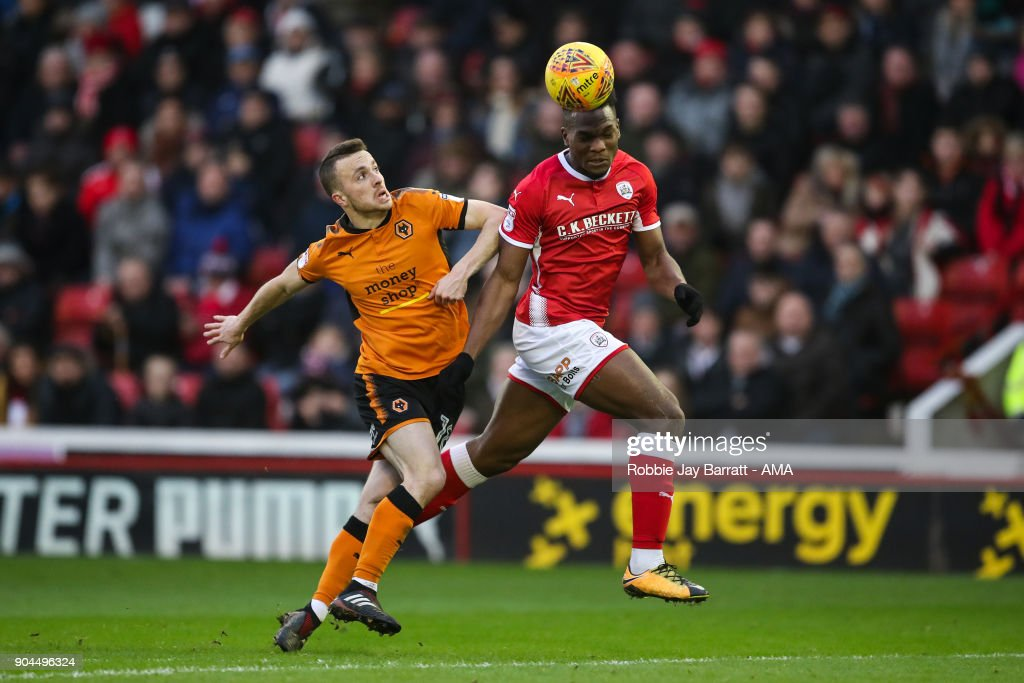 Diogo Jota of Wolverhampton Wanderers and Dimitri Cavare of Barnsley during the Sky Bet Championship match between Barnsley and Wolverhampton at Oakwell Stadium on January 13, 2018 in Barnsley, England.