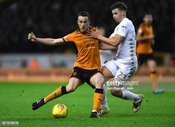 Diogo Jota of Wolverhampton Wanderers and Kalvin Phillps of Leeds United during the Sky Bet Championship match between Wolverhampton and Leeds United...